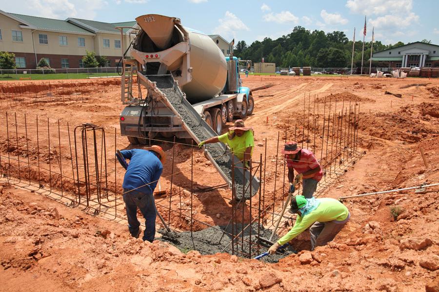 GCS Fine Arts pouring concrete