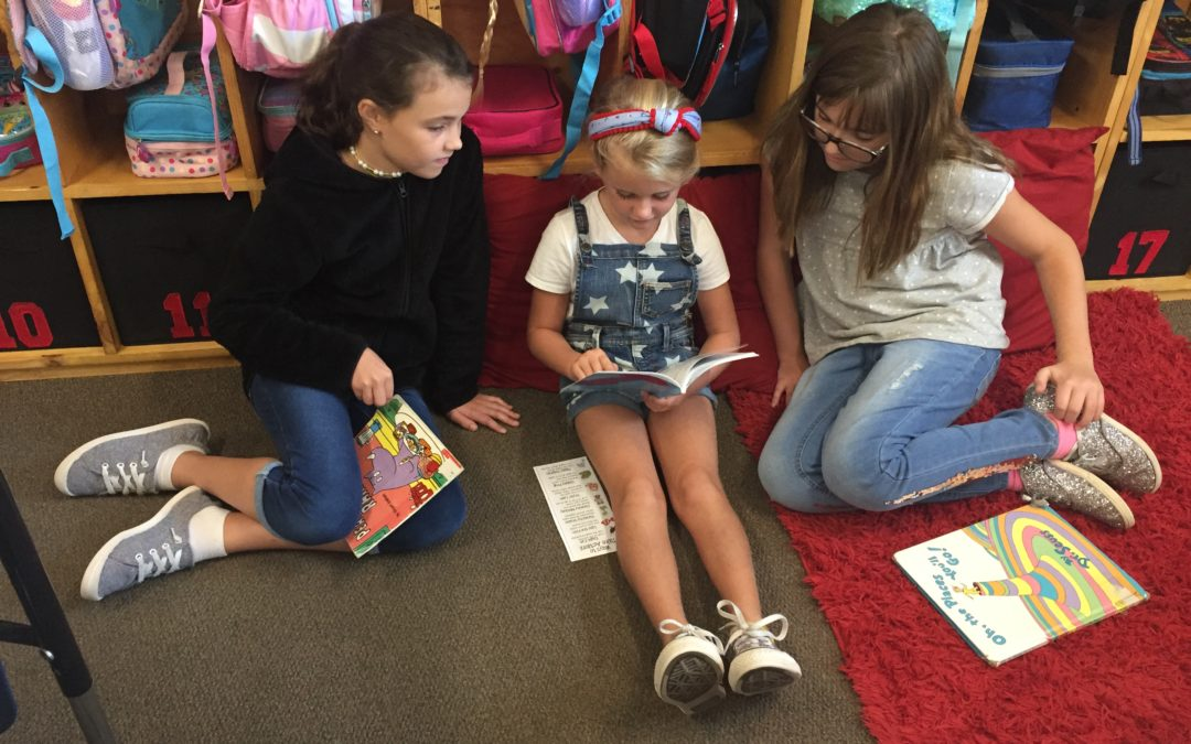 1st graders with their reading buddies from 5th grade