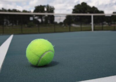 Tennis Coach Needed
